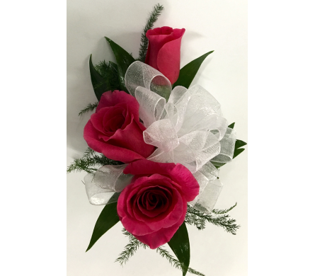 3 Hot Pink Sweetheart Roses in a Wrist Corsage in Wyoming MI, Wyoming Stuyvesant Floral