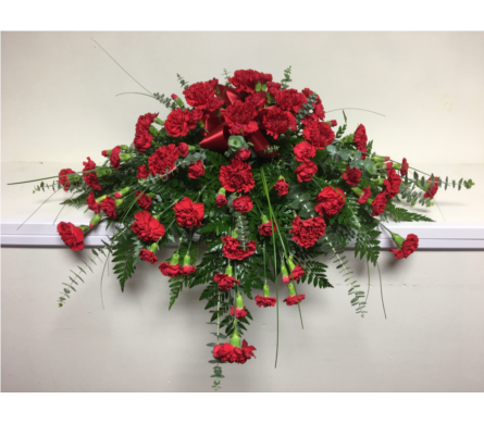 Red Carnation Casket Spray in Wyoming MI, Wyoming Stuyvesant Floral