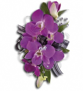 Purple Promise Wristlet in Spokane WA, Peters And Sons Flowers & Gift
