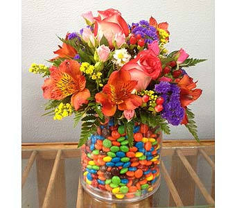 M&M's Container filled with Flowers in Portland OR, Portland Bakery Delivery