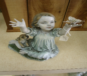 Girl with Puppy and Butterfly Figurine in Ionia MI, Sid's Flower Shop