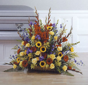 Triadic Fireside Basket in Red, Yellow and Blue in Randallstown MD, Raimondi's Funeral Flowers