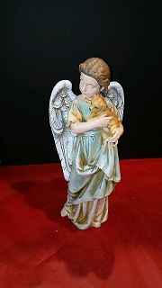 ANGEL HOLDING A PUPPY in Bay City MI, Keit's Flowers