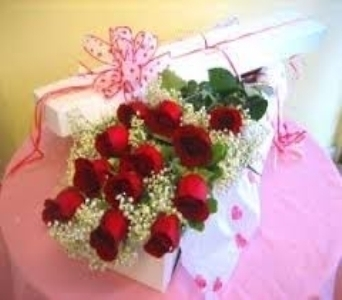 A dozen roses boxed with Baby's Breath & Green in North Bay ON, The Flower Garden