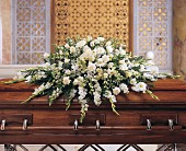 Delux Pure White Casket Spray by Petals & Stems in Dallas TX, Petals & Stems Florist