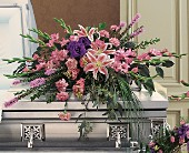 Triumphant Casket Spray by Petals & Stems in Dallas TX, Petals & Stems Florist