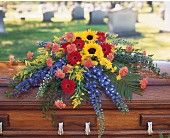 Vibrant Summer Casket Spray by Petals & Stems in Dallas TX, Petals & Stems Florist