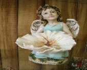 Angel with Flower Bowl in Ionia MI, Sid's Flower Shop